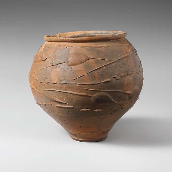 Terracotta beaker with barbotine decoration