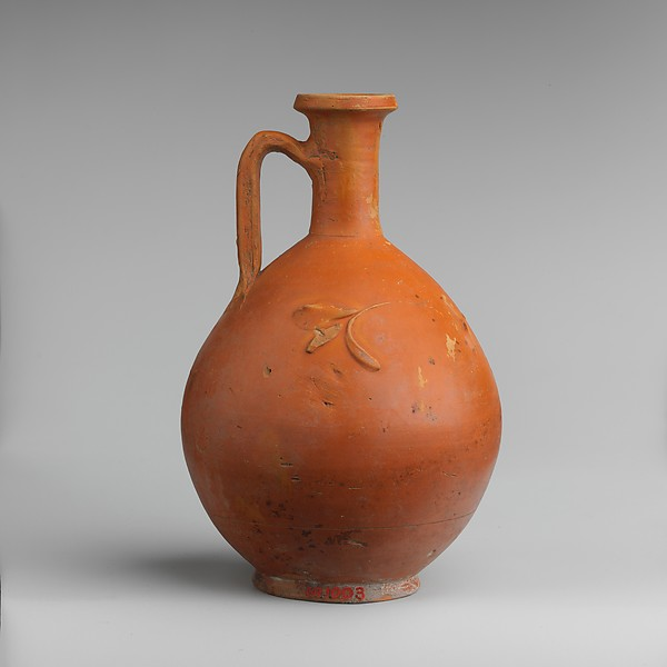 Terracotta jug with barbotine decoration