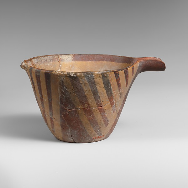 Terracotta spouted conical bowl