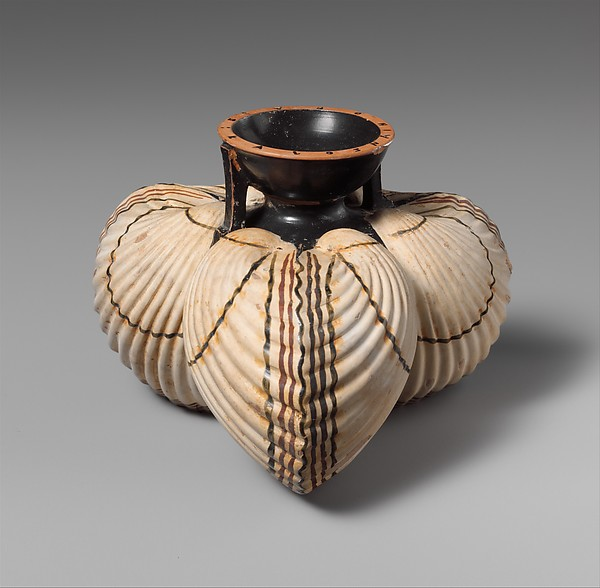 Terracotta aryballos (oil flask) in the form of three cockleshells