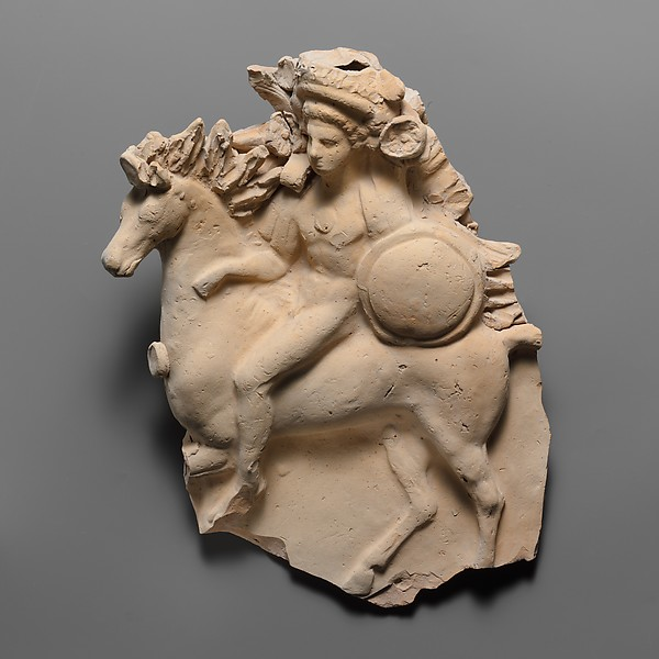 Terracotta relief of a horseman