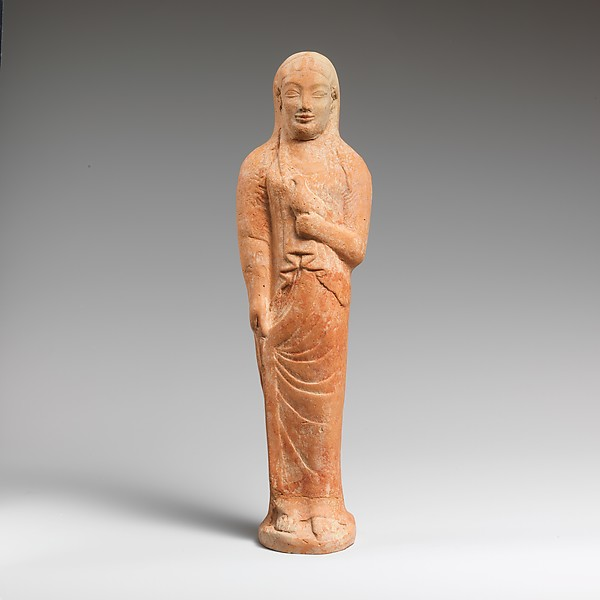 Terracotta statuette of a woman holding a bird