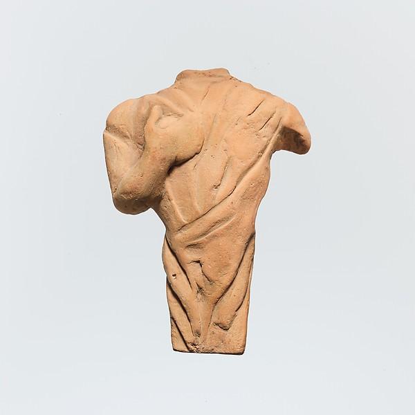 Terracotta statuette of a draped figure, probably female