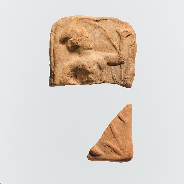 Two fragments of a terracotta plaque