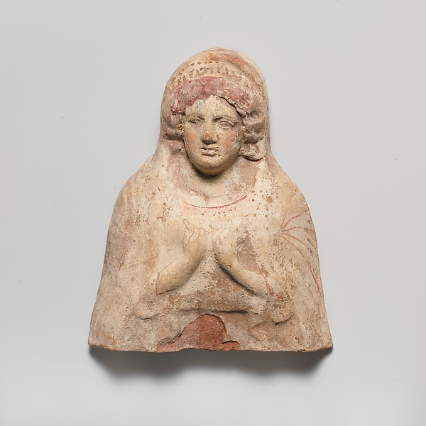 Terracotta relief bust of a woman