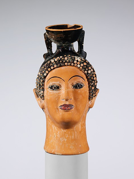 Terracotta aryballos (perfume bottle) in the shape of a woman's head