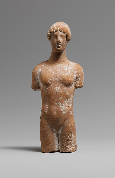 Terracotta head and torso of a woman