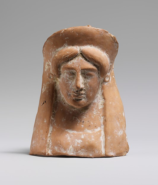 Terracotta relief with the head and neck of a woman