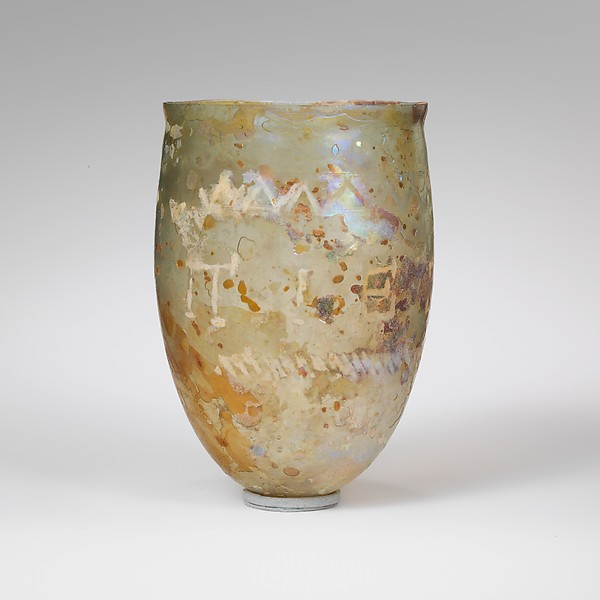 Glass beaker with cut inscription