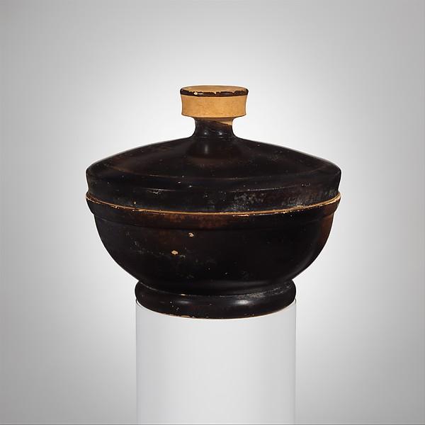 Terracotta covered bowl