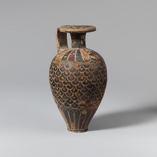 Terracotta pointed aryballos (oil flask)