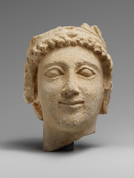 Limestone head of a wreathed youth
