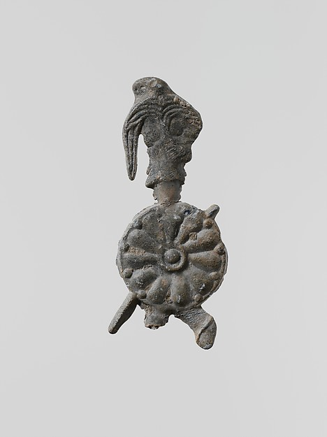 Lead figure of a warrior with a helmet, shield, and spear
