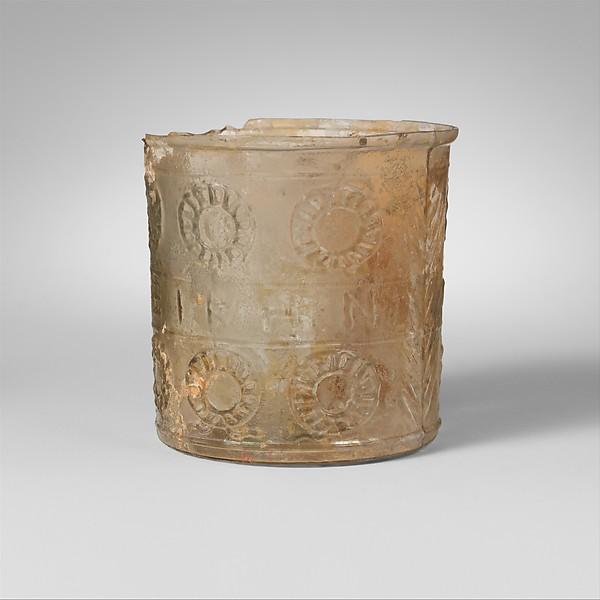 Glass beaker with inscription