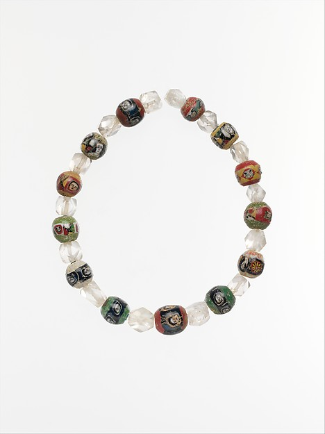 String of mosaic glass and rock crystal beads