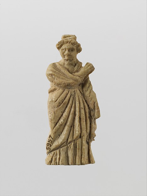 Bone statuette of a draped woman