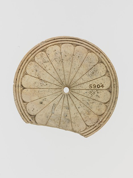 Ivory disk with a rosette
