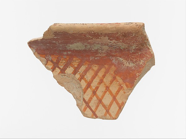 Terracotta rim fragment with cross-hatching beneath band