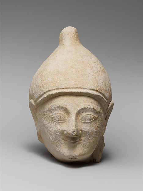 Limestone head of a man wearing a helmet