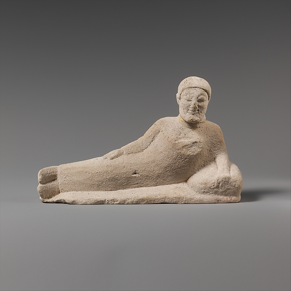 Limestone statuette of a reclining banqueter