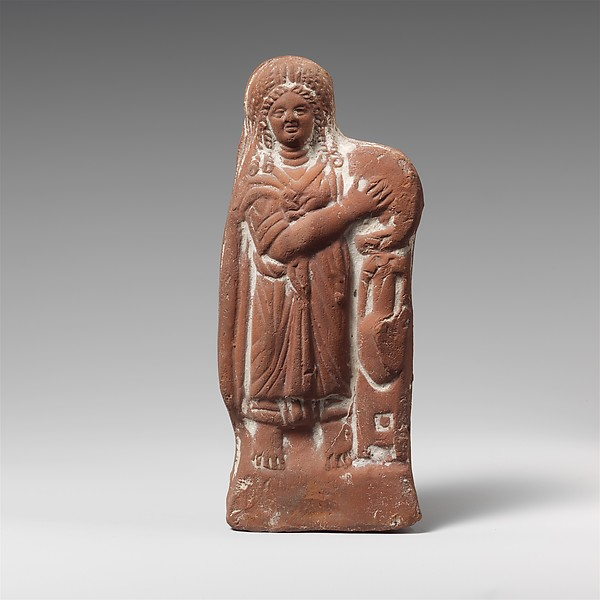 Terracotta statuette of a woman with tympanum