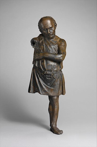 Bronze statuette of an artisan with silver eyes