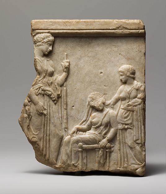 Marble votive relief fragment of goddesses, mother, nurse, and infant