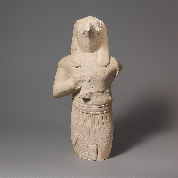 Limestone statuette of a male figure with Egyptianizing features
