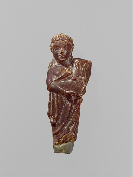 Pendant: woman carrying a child