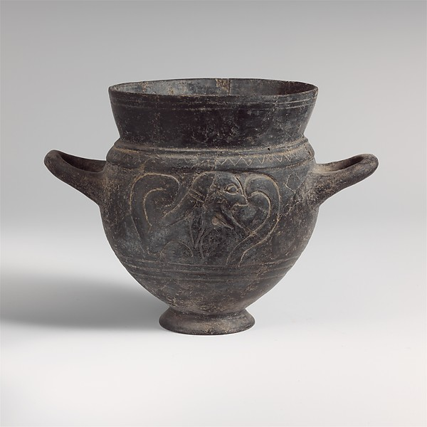 Terracotta drinking cup with two handles