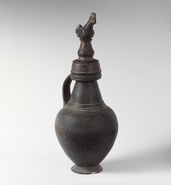 Terracotta jug with lid