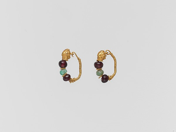 Gold earring with woman's head and beryl and garnet beads