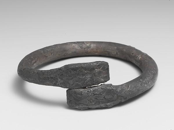 Silver bracelet ending in snake's heads