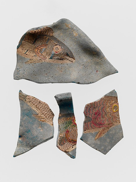 Glass fragments of bowl decorated with mosaic fish