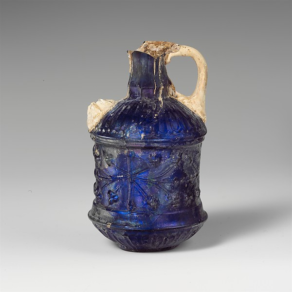 Glass two-handled bottle