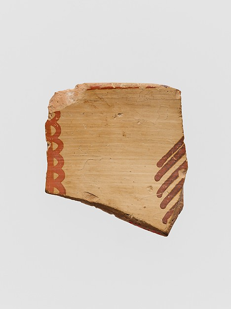 Terracotta rim fragment with curvilinear motifs