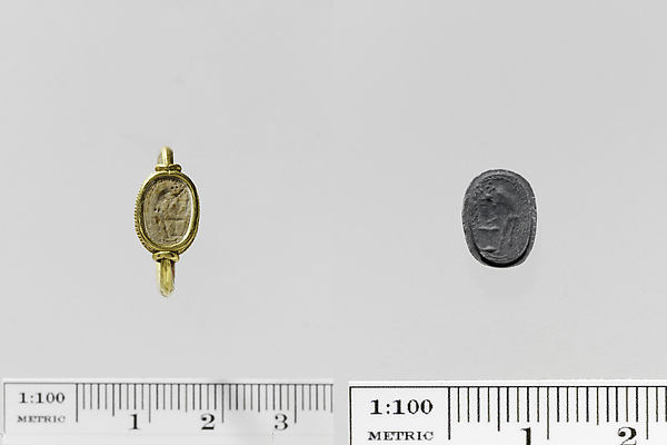 Steatite scaraboid seal set in a gold swivel ring