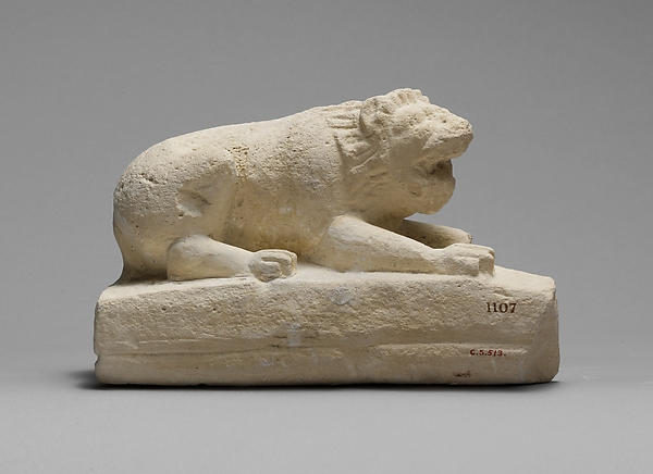 Limestone statuette of a lion