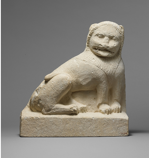 Limestone statue of a seated lion