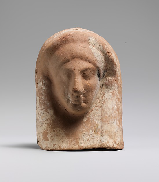 Terracotta relief with head of a woman