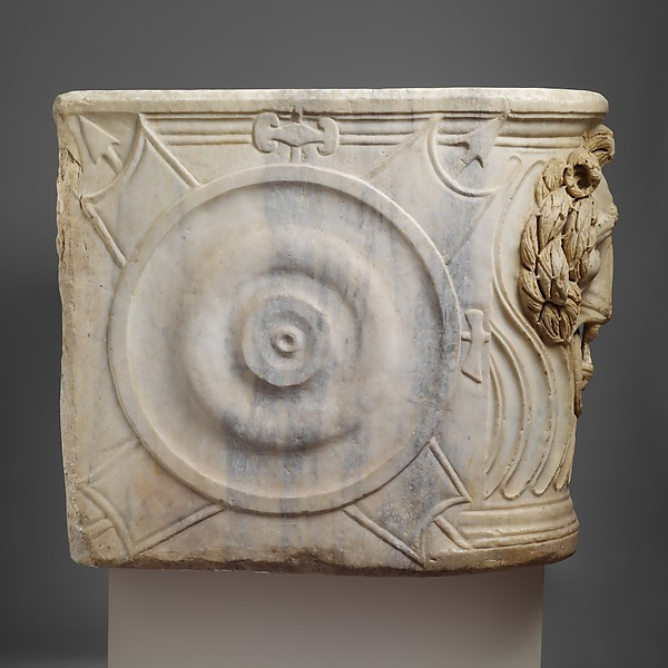 Marble strigilated sarcophagus