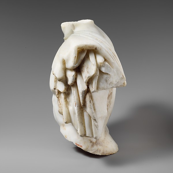 Upper part of a marble torso of a man