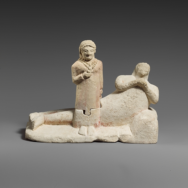 Limestone group of a male banqueter and a woman