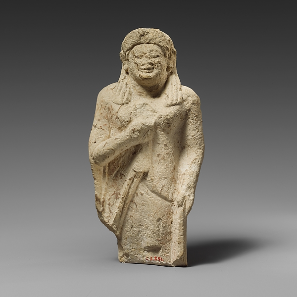 Limestone statuette of a female votary of the kore type