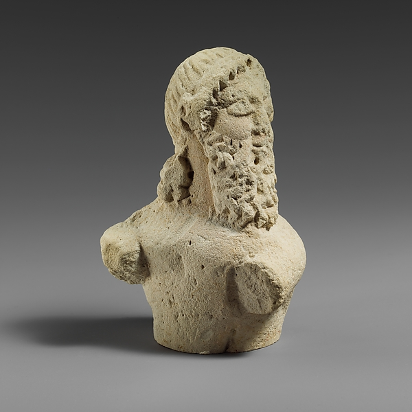 Fragment of a limestone statuette of a silen (?)