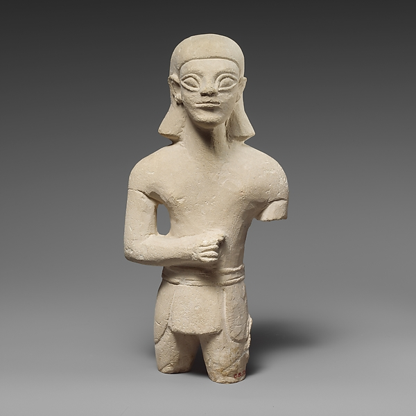 Limestone statuette of a beardless male votary in Egyptianizing dress