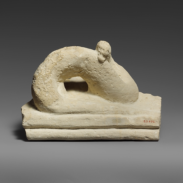 Two fragments of a limestone sarcophagus lid with snakes