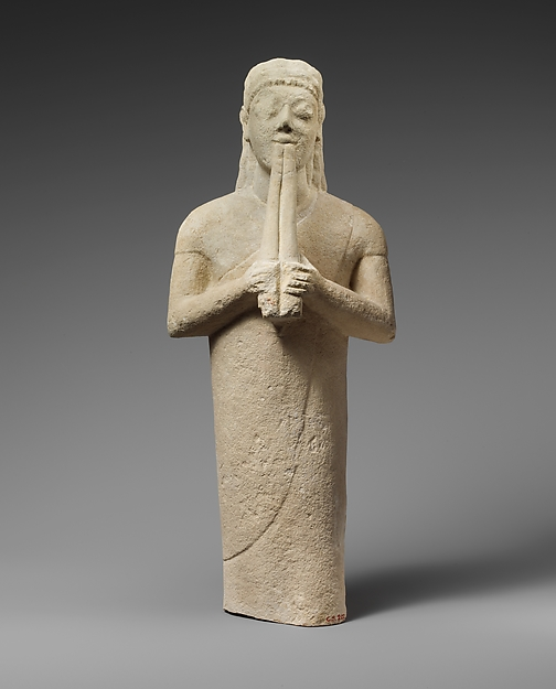 Limestone statuette of a male aulos player