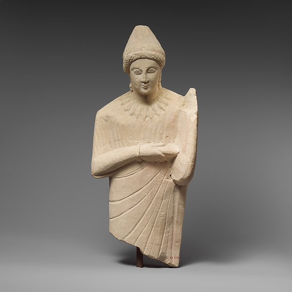 Limestone statuette of a female lyre player