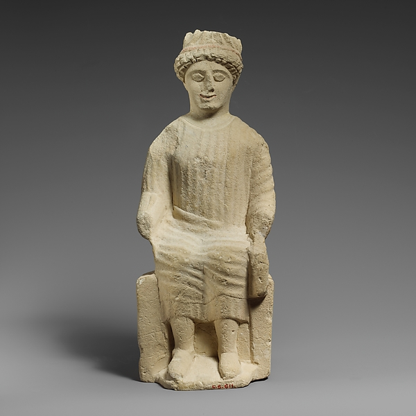 Limestone statuette of a seated beardless male votary